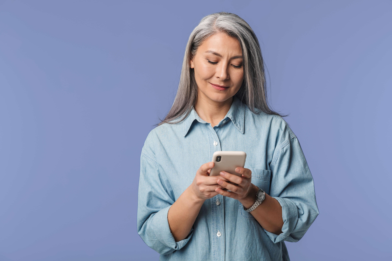 Woman using phone indoors 2
